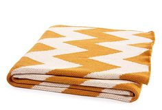 A bright Chevron pattern throw, comes in several colors on One Kings Lane https://www.onekingslane.com/product/14258/711974