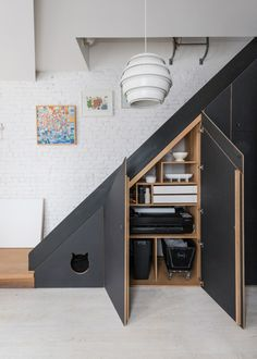 Pendant light by Alvar Aalto. Interior design and under-stair storage by Studio Nous and Oliver Valle Office of Brooklyn. From Brownstoner. Office Under Stairs, Under Stairs Pantry, Space Under Stairs, Staircase Storage, Staircase Design, Under Stair Storage, Attic Storage, Closet Storage, Alvar Aalto