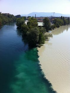 The junction of the Rhone and Arve rivers in Geneva, Switzerland. The river on the left is the Rhone, which is just exiting Lake Lehman. The river on the right is the Arve, which receives water from the many glaciers of the Chamonix valley before flowing into the Rhone, where its much higher level of silt brings forth a striking contrast between the two rivers.