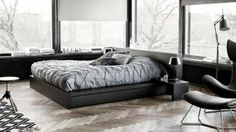 platform bed with hidden storage drawers for men's bedroom