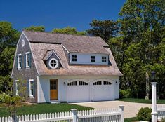 Exquisite Barn Style Garage With Apartment Plans in Garage And Shed Beach design ideas with Exquisite arched garage door blue shingles dormer driveway gambrel roof garage garage door