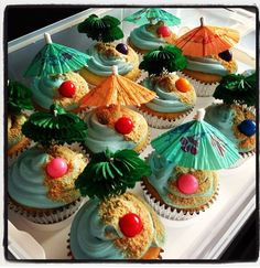 Umbrella with blue frosting and brown sugar sand, love it!