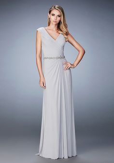 Lovely net jersey evening gown with pleated bodice and cap sleeves. Features a jeweled belt and skirt sweeping to the left hip. Back zipper closure. Evening Size Chart B.