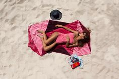 vertty reinvents beach towels with triangle shape in australia