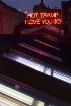 "12 MONTHS OF NEON LOVE - Valentines Day 2011, Victoria Lucas and Richard William Wheater created twelve lyrical statements in large red neon text on the roof of the Neon Workshop in Wakefield, West Yorkshire. ""Hot tramp, I love you so..."" - Rebel, Rebel - Bowie"