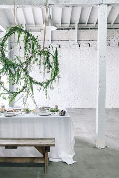 Spring table setting with floral wreath via Anne Sage