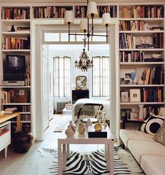 NYC 1 bedroom apartment, filled with lots of books. Yet the bookcase is built into the wall so it doesn't have a cluttered look.