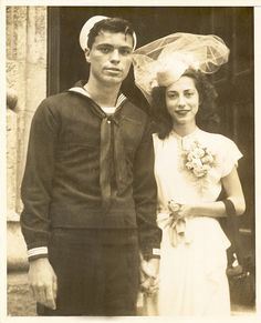 A 1940s bride & her sailor groom. So perfect for my novel! LOVE this pic!  #1940s #vintage #wedding