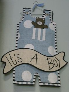 """Announce the big news with painted, stuffed burlap pants from Mud Pie. A fun centerpiece for the baby shower, or hang on the door of the delivery room or at home. So many uses for this darling """"It's a Boy"""" hanger."""