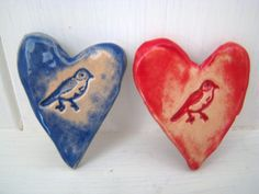 A beautiful ceramic heart shaped brooch. A cheerful birdie is imprinted into the wet clay. Red or blue glaze is available, just let me know which youd prefer in Note to Seller, or may using the drop down selection choice. There is a antique finish pin on the back for pinning to you lapel or bag. The brooches vary slightly from each other but they typically 3.5cm long and about the same across the widest part of the heart. The 4th picture shows how they are presented - pinned onto a card…