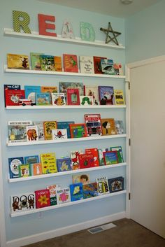 "a wall of childrens' books as ""art"""