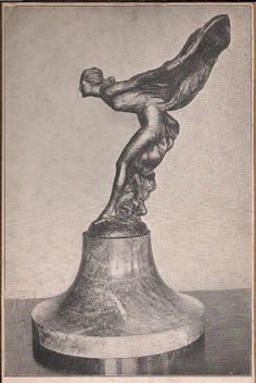 """The Spirit of Ecstasy"", 1911. This one is 28 inches high and is at the Rolls Royce showrooms in New York.      ""The Spirit of Ecstasy"", 1911, shown in a desk display form.    ""The Spirit of Ecstasy"", 1911. This one is 28 inches high and is at the Rolls Royce showrooms in New York."