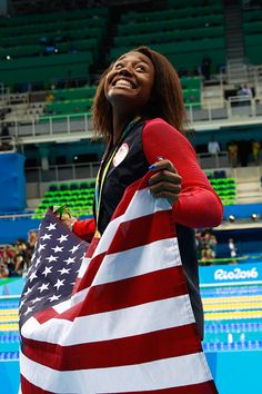 #RIO2016 Gold medalist Simone Manuel of the United States celebrates during the medal ceremony for the Women's 100m Freestyle Final on Day 6 of the Rio 2016...