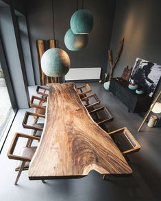 Woudz // monolith wooden table with special edition chairs & oxidized copper sphere lighting