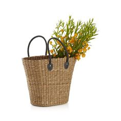 Eco-friendly bankuang grass is woven into a naturally appealing, tapered tote that stands up to marketing or trips to the beach. Tote with rich natural color variations is finished with grey faux leather strap handles, reinforced with metal rivets.