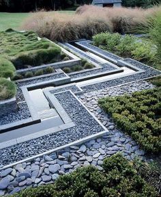 water framed by grey pebbles and geometric planting: