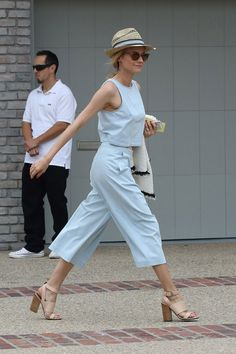 Diane Kruger in Pale Blue Crop, Pants & Panama style hat.