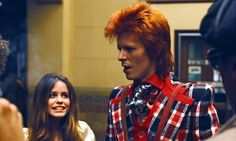 David Bowie pictured with a fan in the 1970s, in his Ziggy Stardust phase.