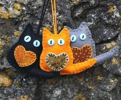 Handmade felt cat ornaments for Autumn, Fall or Halloween decor. A set of three little cats made of grey, orange and black felt with appliqued hearts and button eyes. Each cat measures inches / Halloween Ornaments, Felt Christmas Ornaments, Halloween Crafts, Christmas Crafts, Halloween Decorations, Fall Halloween, Xmas, Needle Felted, Felt Decorations