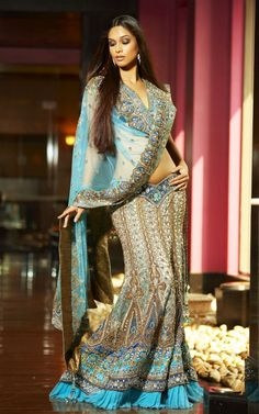 Aqua Blue and Royal Blue Lehenga   A combination glamour and style, the entire outfit is embellished with Swaroski Crystals, Zardosi embroidery and Stone Highlights