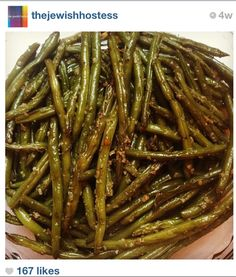 garlic string beans, the jewish hostess, Cook in Wok with 2 tablespoons minced garlic and oil. Then transfer to pyrex and heat in oven.