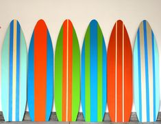 These are beachy and playful. They remind me of Italian design with regards to the stripes and Popsicles for the color selection.