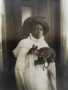 A young Kenyan woman holds her pet deer in Mombassa, March 1909.Photograph by Underwood and Underwood