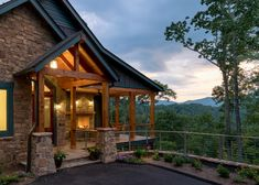 This home uses natural materials—wood, stone—for a look that's harmonious with its breathtaking setting. A wraparound porch shows off every inch of the wow views.