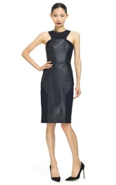 This form-fitting leather sheath dress is strapless and features a panel-seamed construction with a contrast fabric trimmed yoke and inserts   Back zip   100% leather with 100% cotton accents