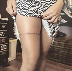 Banded quote on thigh by Cholo Ink
