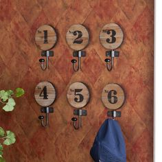 "To DIY: These numbered hooks - use ""J-hook"" attached to bottom of each round piece of wood."