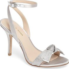 Pelle Moda Women's Shoes in Silver Leather Color. Sparkling crystals embellish a striking evening sandal topped by a slender ankle strap and lofted by a tapered heel.