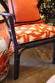I love the paint color of the chair and the matching trim on the pillow.