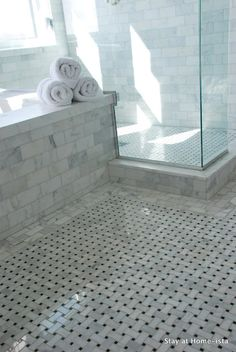 Beautiful marble bathroom with marble basketweave tile floor, seamless glass shower and marble subway tiles shower surround Marble Tile Bathroom, White Marble Bathrooms, Marble Subway Tiles, Bathroom Floor Tiles, Marble Floor, Tile Floor, Carrara Marble, Shower Floor, Wall Tile