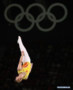 China's Dong Dong competes during the men's final of Trampoline Gymnastics at the 2016 Rio Olympic Games in Rio de Janeiro, Brazil, on Aug. 13, 2016. Dong Dong won the silver medal.  http://www.chinasportsbeat.com/2016/08/chinas-dong-dong-takes-silver-medal-of.html
