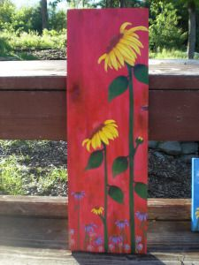 Sunflower painting -- Use canvases to paint single sunflowers with long stems in a verticle fixture. total of 9 canvases Pallet Painting, Pallet Art, Tole Painting, Painting On Wood, Garden Poles, Painted Boards, Painted Wood, Sunflower Art, Fence Art