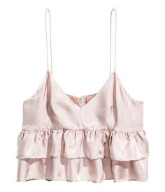 Powder pink. Short top in woven viscose fabric with a sheen. V-neck at front, narrow shoulder straps, seam below bust with two ruffles, and fastening at