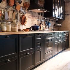 Traditional dark IKEA kitchen with solid wood worktops and traditional style appliances
