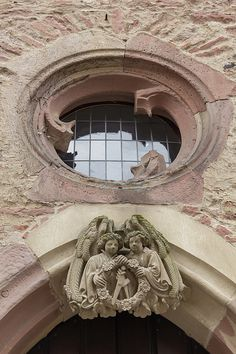 I love the round window above the Angel Crest on the Ruprechstbau at Heidelberg Castle in Germany. The Ruprechtsbau is one of the oldest sections of the Castle.