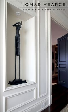 gallery hallway | panelling | sculpture