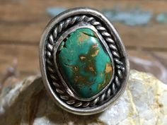"""Sterling silver Navajo ring set with Royston Mine turquoise that is natural, un-treated. It has natural cracks and is stable in the setting. Size: 7 1/2 Face measures 7/8"""" long by 3/4"""" wide. Weight: 8"""