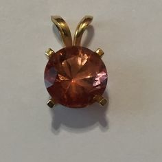 FLASH ✨✨ 20% OFF  MYSTIC TOPAZ GLISTENING SWEET 10k. Salmon Topaz. Beautiful colors Sparkle within and out.  This 8mm Round Gem is so Radiant.  The Colors sparkle and the lights dance from within...NWOT. Truly lovely ... I purchased gem & 10k gold casting. Price is firm.. Colors of Topaz Jewelry Necklaces