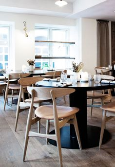 RESTAURANT KADEAU, Copenhagen, Denmark. Pieces: CH33 chair designed by Hans J. Wegner #carlhansenandson
