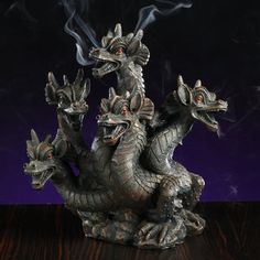 """Enjoy the aroma of your favorite incense with the Elegant Expressions by Hosley 5-Headed Smoke Breathing Dragon Incense Burner. This medieval design incense burner features a five-headed dragon that blows smoke out of its mouth and ears. This unique piece will add style to your decor.""  - It's called a HYDRA people! :P"