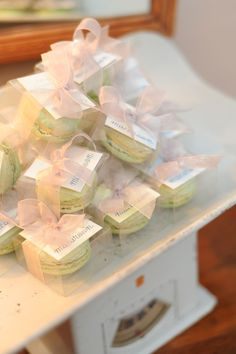 Macaroon favors in antique baby scale for baby shower. stylingmyeveryday.com