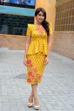 Regina Cassandra in a yellow embroidered peplum dress designed by Shilpa Reddy for a press meet. Regina Cassandra, Beautiful Actresses, Indian Wear, Skirt Fashion, Kurti, Designer Dresses, Peplum Dress, Casual Outfits, Short Sleeve Dresses