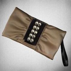 Simply Vera by Vera Wang wristlet/clutch Fancy clutch/wristlet with small area inside for cards, a lipstick and phone. Most of the size is the design as opposed to space. Never used. It's a brown/khaki color with black accents and jewels on the front. Simply Vera Vera Wang Bags Clutches & Wristlets
