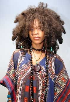 Erykah Badu style evolution: from towering head wraps yo crazy top hats. #NaturalHair