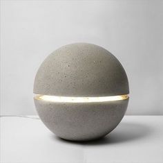 LAMPE GAYALUX - The lamp Gayalux concrete is both sculptural and light. This ball is anchored to the mineral soil, it seems levitate with his ray of light passing through. Concrete leaves the architecture for the object, the block is curved like a skin. Concrete Light, Concrete Cement, Concrete Furniture, Concrete Projects, Concrete Design, Concrete Leaves, Urban Furniture, Polished Concrete, Plywood Furniture