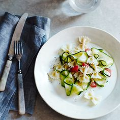 Garden-fresh zucchini and tomatoes make a beautiful pasta, perfect for a warm summer night's dinner. It can be served hot or at room temperature, eith...